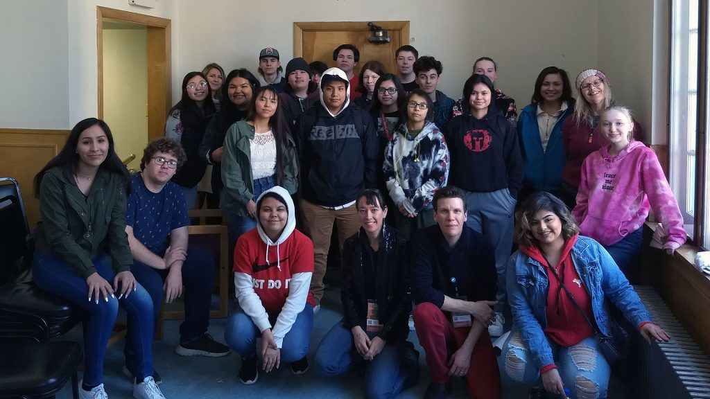 Sisters Rising crew with students