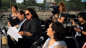 Film Still from Rematriation: Joanne Shenandoah, reading on stage